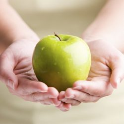 Woman holding fresh apple